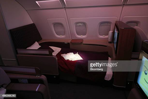 Passenger seating and a bed sit in the first class cabin of an Airbus A380800 aircraft operated by Qatar Airways Ltd on the opening day of the 14th...