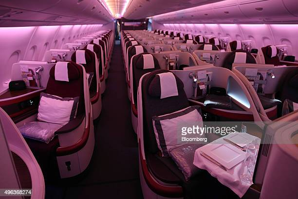 Passenger seating sits in the business class cabin of an Airbus A380800 aircraft operated by Qatar Airways Ltd on the opening day of the 14th Dubai...