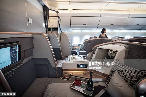 Passenger seats sit in the business class cabin of an Airbus SE A350 aircraft operated by Singapore Airlines Ltd during an arrival ceremony at Changi...