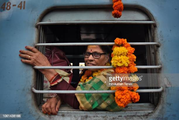A passenger seen sitting inside the newly launched tourist train 'Ramayana Express' by Indian Railway Catering and Tourism Corporation from...