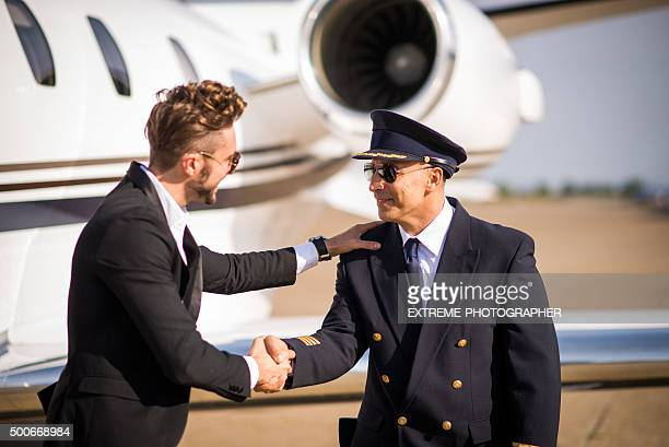 Passenger shaking hands with pilot