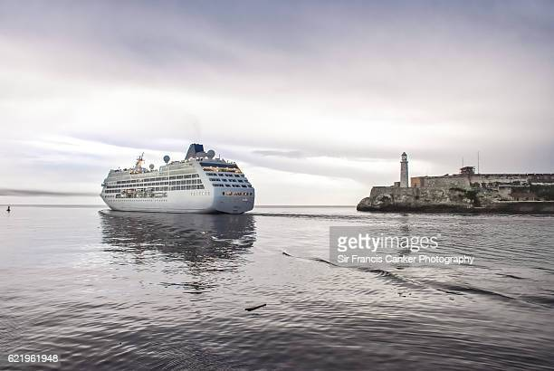Passenger ship against Morro Castle and old stone Morro lighthouse departing Havana
