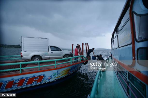 Passenger ship and freight vessel seen on the Lake Toba The Lake Toba in the north of Sumatra as been formed during the occurrence of a super...