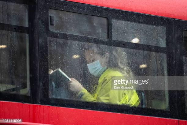 Passenger sits on a bus near Waterloo Station on October 21, 2020 in London, England. The London Mayor's office has released news that the Government...