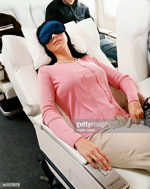 Passenger Sleeping in an Aircraft Cabin Interior