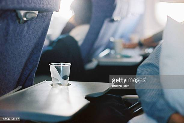 Passenger sleeping in an airplane