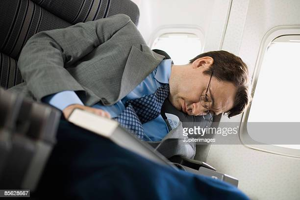 Passenger sleeping on airplane