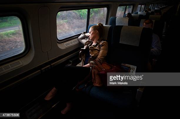 A passenger sleeps as she rides the first Amtrak northbound service from 30th Street Station on a 553am departing train after last week's derailment...