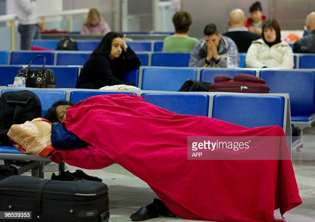 A passenger sleeps on seats at Gatwick airport in southern England on April 19 following the closure of the airport due to volcanic ash emitted from...
