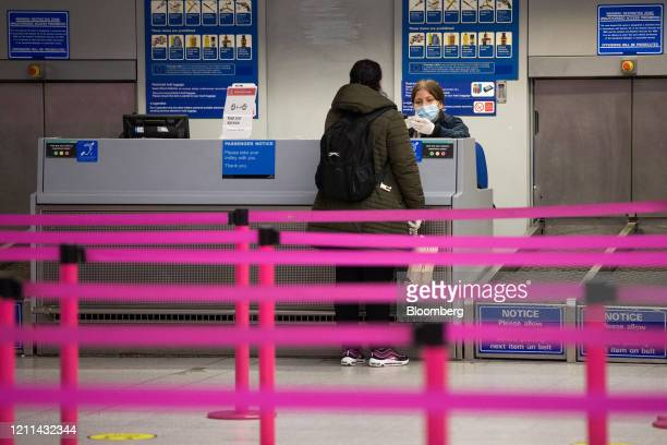 A passenger speaks to a member of staff at checkin area for Wizz Air Holdings Plc at London Luton Airport in Luton UK on Friday May 1 2020Wizz...