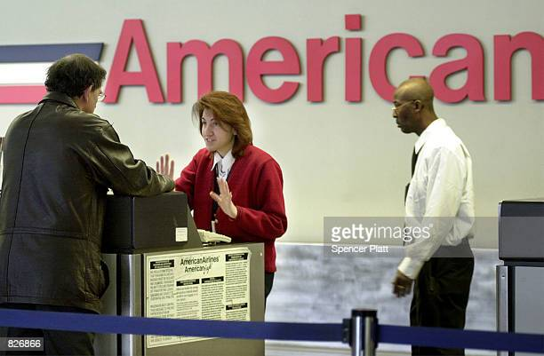 A passenger speaks with an American Airlines attendant March 2 2001 at John F Kennedy International airport in New York City A federal judge issued a...
