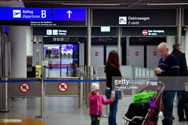 Passenger stands in front a closed way to the security checks at Frankfurt Airport during a strike by security personnel on January 15, 2019 in...