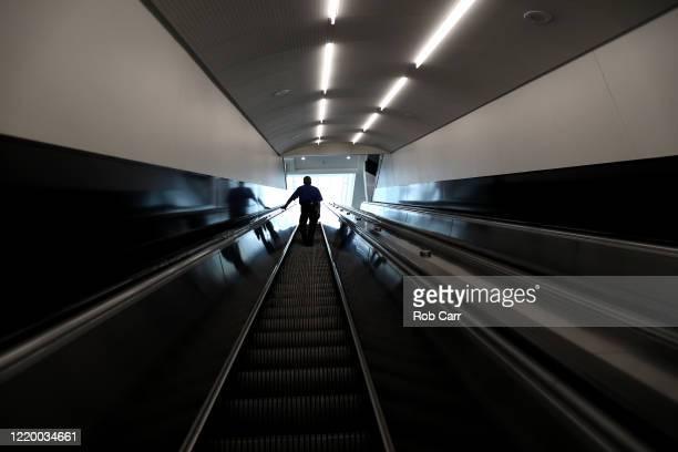 A passenger takes the escalator up to terminal B at HartsfieldJackson Atlanta International Airport on April 20 2020 in Atlanta Georgia The airline...