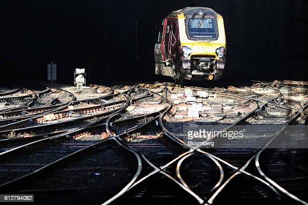 A passenger train approaches Birmingham New Street station operated by Network Rail Ltd in Birmingham UK on Tuesday Oct 4 2016 UK Prime Minister...