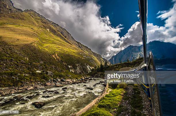 Passenger Train By River In Andes