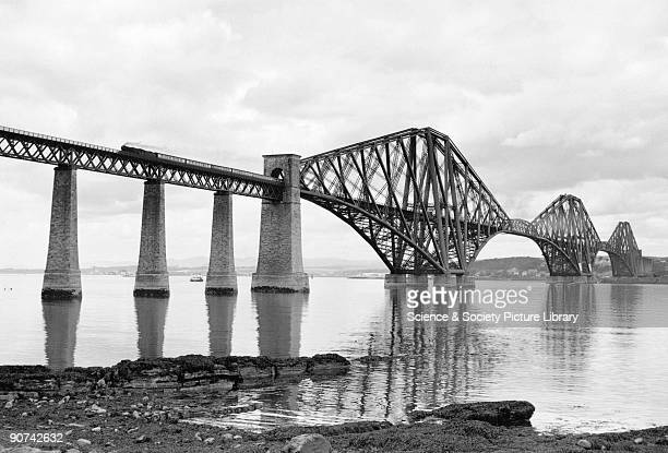 A passenger train crosses the Forth Bridge c 1950s Photograph by Bishop Eric Treacy Treacy was often allowed special access to many areas denied to...