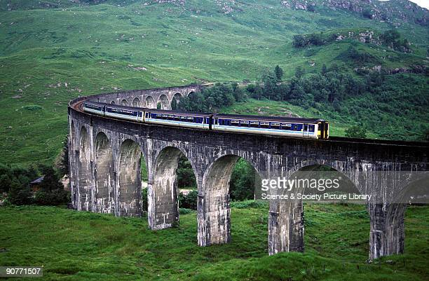 Passenger train crossing Glenfinnan Viaduct on the West Highland Railway by Lynn Patrick 1997 This viaduct was built from 1897 to 1901 and was the...