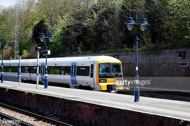 Passenger train entering railway station