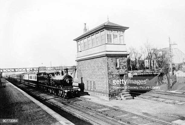 Passenger train hauled by a 440 locomotive passing a signalbox at Dyce on the Great North of Scotland Railway about 1910 The GNSR was formed in the...