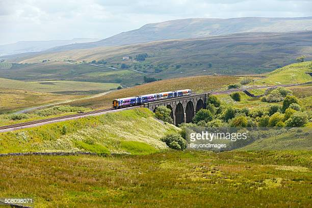 passenger train in spectacular yorkshire dales landscape - leeds stock pictures, royalty-free photos & images