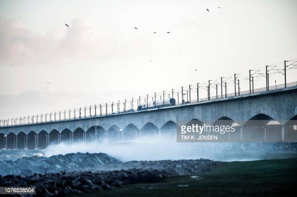 A passenger train is seen on the Great Belt Bridge after a railway accident on January 2 2019 in Nyborg Denmark Several people were killed in a train...