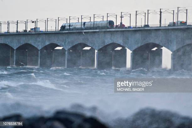 A passenger train is seen on the Great Belt Bridge after a railway accident on January 2 2019 in Nyborg Denmark Six people were killed in a train...