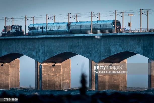 A passenger train is seen on the Great Belt Bridge after a railway accident on January 2 2019 in Nyborg Denmark At least six people were killed in a...