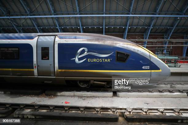 A passenger train operated by Eurostar International Ltd sits stationary on the platform at St Pancras International railway station in London UK on...