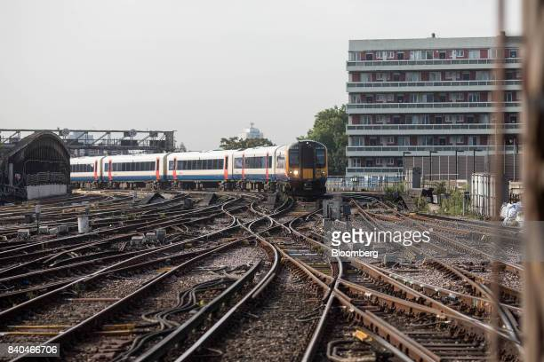 A passenger train operated by South West Trains Ltd arrives at London Waterloo railway station in London UK on Tuesday Aug 29 2017 The 800...
