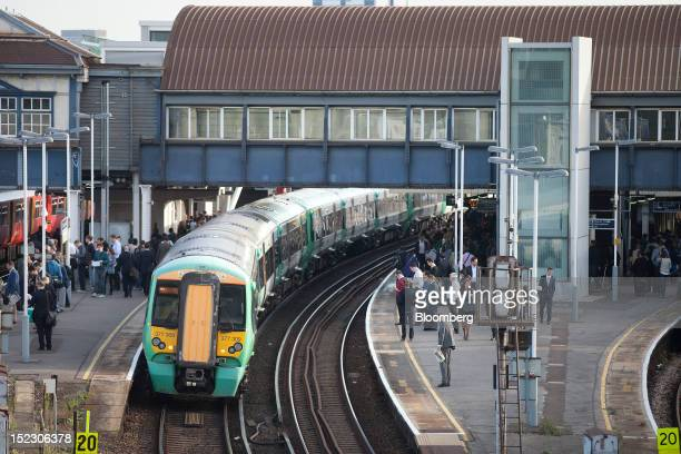 A passenger train operated by Southern Railway Ltd stands at a platform at Clapham Junction railway station in London UK on Tuesday Sept 18 2012 UK...