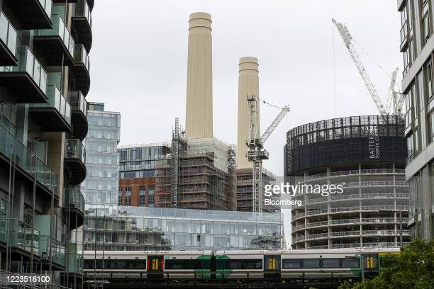 Passenger train operated on the Southern franchise by Govia Thameslink Railway Ltd. Travels along railway tracks in view of construction work on the...