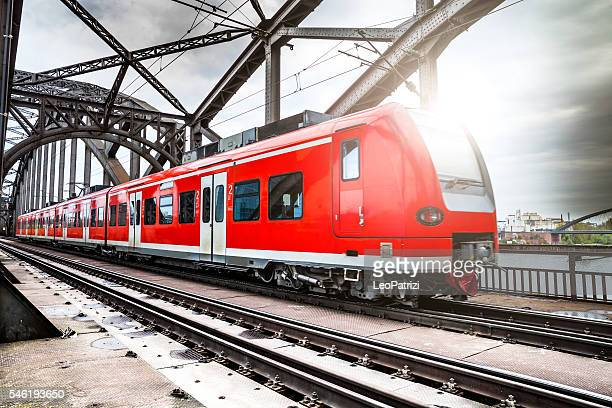 Passenger Train passing on a bridge in Frankfurt, Germany
