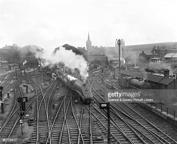 Passenger train pulled by an A4 class 462 locomotive at King's Cross Steam locomotives were still common in the 1950s However steam traction was...