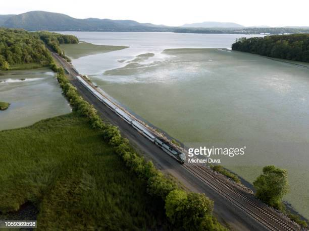 passenger train traveling up the hudson river - hudson river stock pictures, royalty-free photos & images