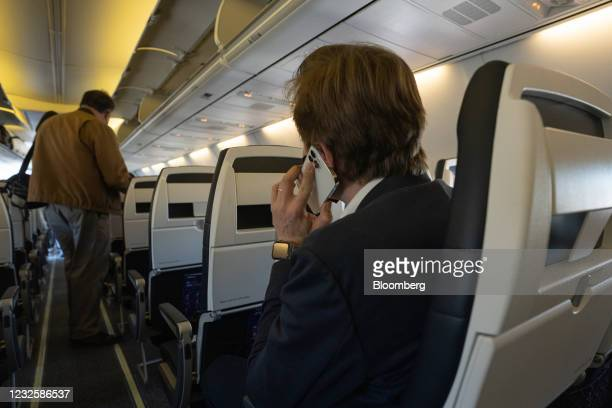 Passenger uses a smartphone onboard a Boeing Co. 737-800 operated by Avelo Airlines ahead of the airline's inaugural flight at Hollywood Burbank...