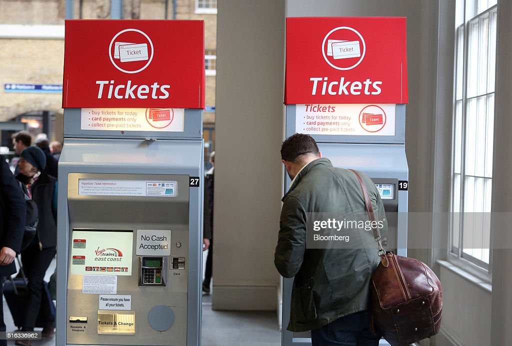 A passenger uses an automated ticket machine at Kings Cross station, in London, U.K., on Friday, March 18, 2016. Virgin Trains will revive plans to offer high-speed Internet access on Europes busiest rail route in a bid to beat the plane and persuade business people to travel outside peak hours. Photographer: Chris Ratcliffe/Bloomberg via Getty Images