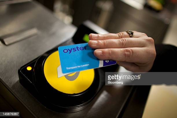 A passenger uses an oyster card to exit Liverpool Street station after traveling on a London Underground tube train in London UK on Thursday June 7...