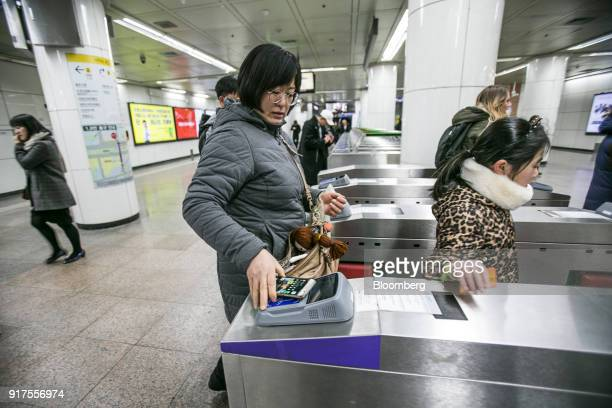 A passenger uses the Samsung Pay Transportation Card Service developed by Samsung Electronics Co at a fare gate inside a subway station in Seoul...