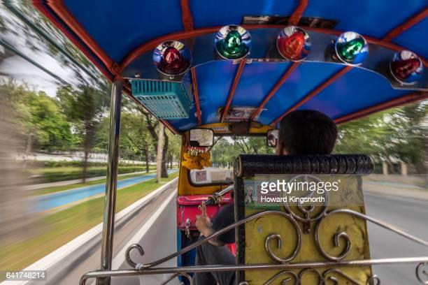 Passenger view from inside a tuk tuk in Bangkok