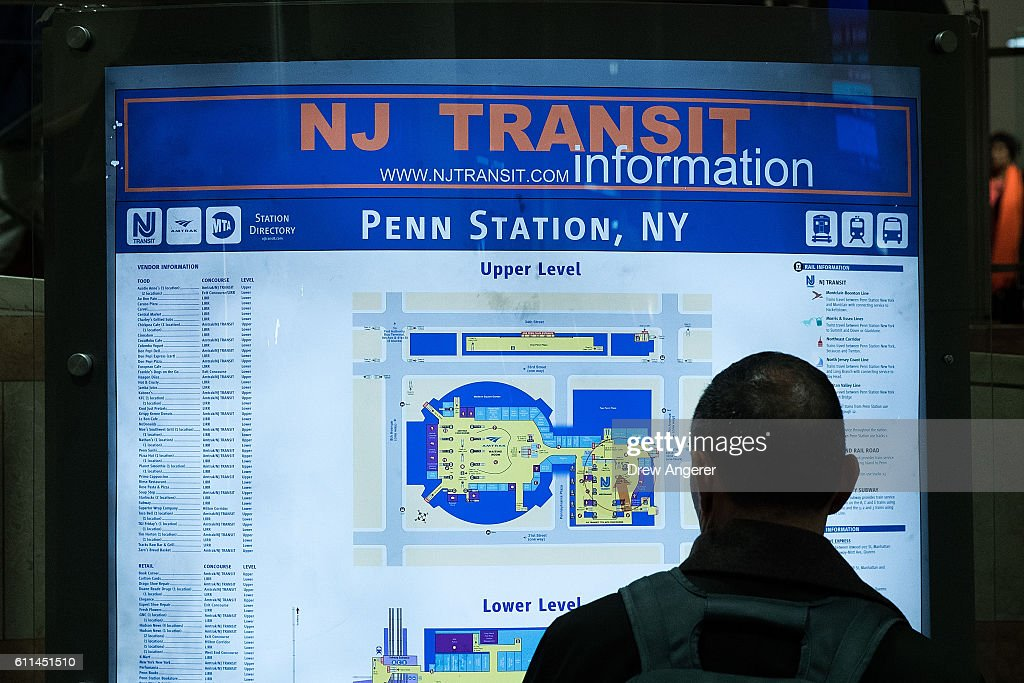A passenger views a New Jersey Transit information map at
