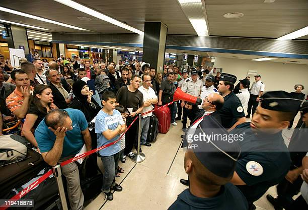 Passenger wait for their flight at Orly airport south of Paris on July 13 2011 as a strike by Air Algerie cabin crew who want a 106percent pay rise...