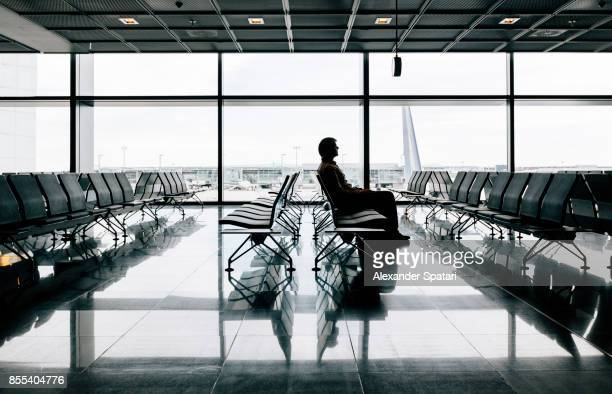 passenger waiting for a flight in an airport - waiting stock pictures, royalty-free photos & images