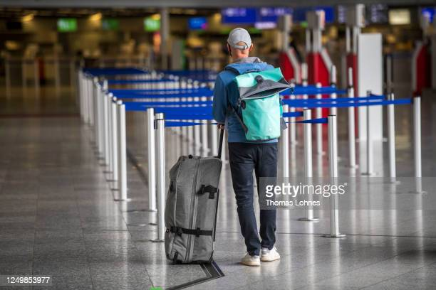 Passenger waits at Frankfurt Airport during the novel coronavirus pandemic on June 15, 2020 in Frankfurt am Main, Germany. Countries across Europe...
