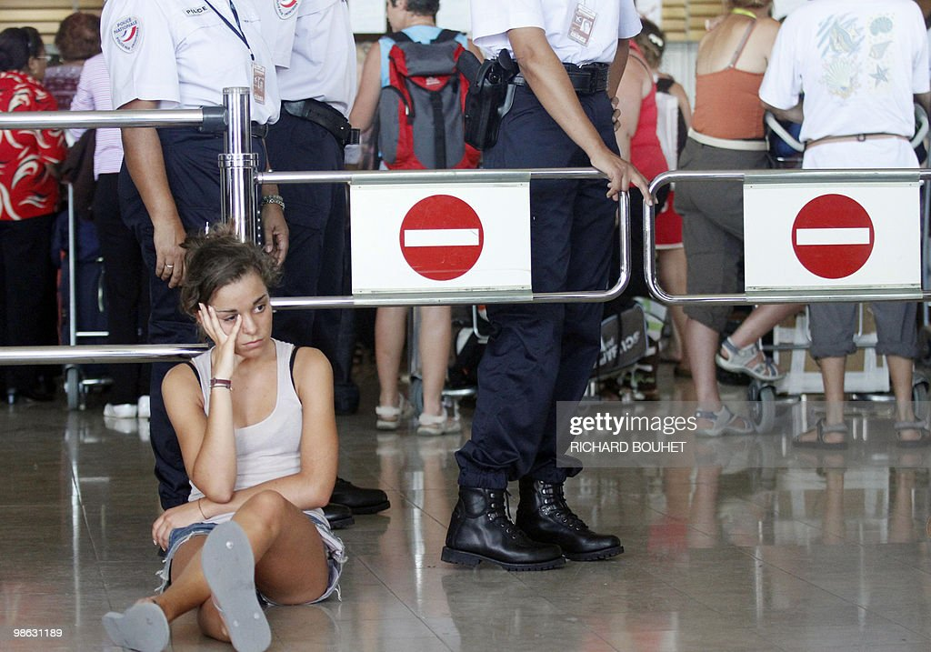 A passenger waits at Gillot airport in the French Indian ocean island of Saint Denis de la Reunion on April 22, 2010. Two thousand and five hundred passengers are stuck after Air France national company didn't charter enough planes as traffic air returned to normal. Nearly seven million passengers have been affected in the world by the disruption of air traffic due to the volcano eruption in Iceland.