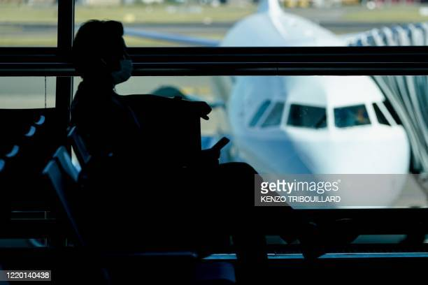 Passenger waits at the boarding gate at Brussels Airport, in Zaventem, on June 15, 2020 as Brussels Airport reopens for travels within Europe and the...