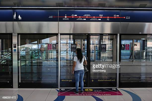 A passenger waits at the entrance to a women and children only cabin at the Dubai Internet City station on the Dubai Tram line in Dubai United Arab...