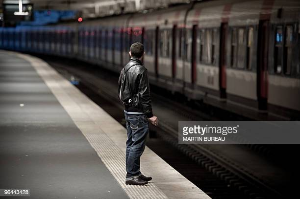 A passenger waits for a train on February 03 in Paris Gare du Nord train station as SNCF faces a 24 hours strike The national rail company SNCF said...