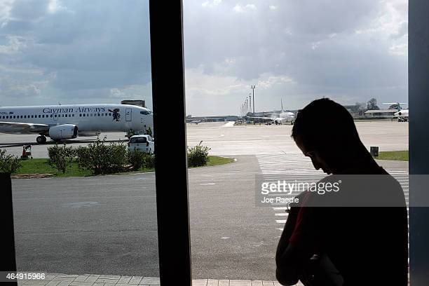 Passenger waits for his Miami-bound plane at José Martí International Airport on March 1, 2015 in Havana, Cuba. The United States and Cuban officials...
