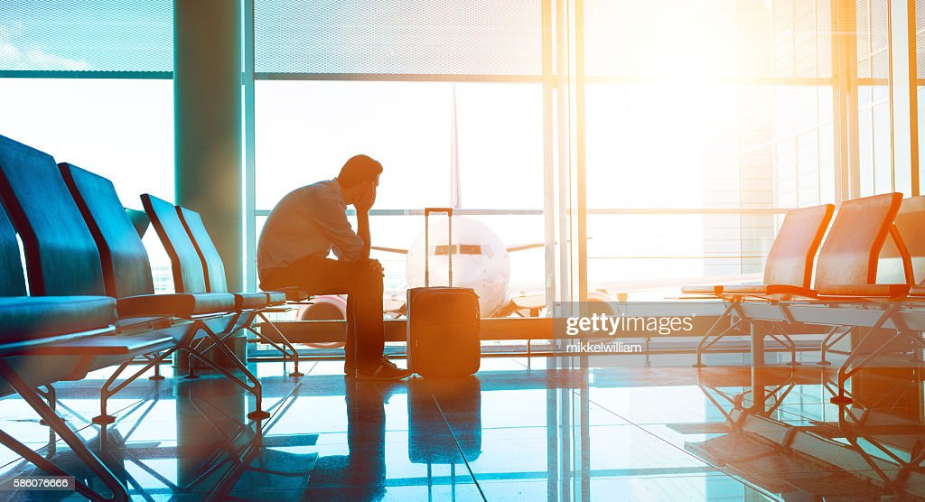 Passenger waits for plane in an airport : Stock Photo