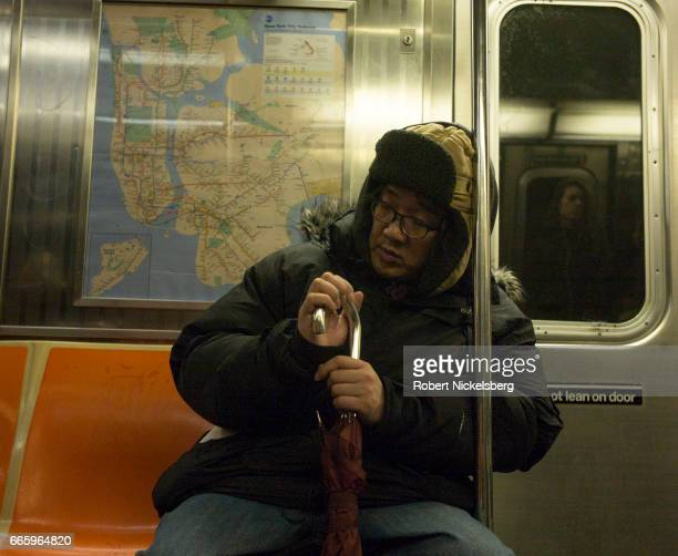 A passenger waits for the next stop while riding the subway March 31 2017 in New York City In 2015 the New York City subway had 5610 daily passenger...